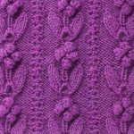 Bobbled flowers placed vertically knit stitch